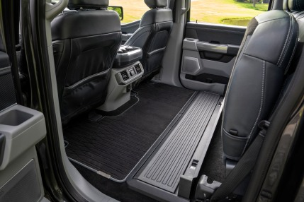 Easily accessed flat load floor in the back of F-150 crew cabs allows customers to carry large items inside the cab.